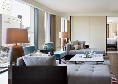 JW Marriott Dongdaemun Square Seoul guest room with sofa, chairs and lamps
