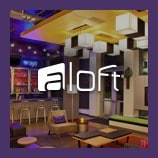 Contemporary indoor seating area, opens the aloft brand page