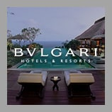 A thatched lanai and pool overlooking the ocean, opens the Bulgari brand page