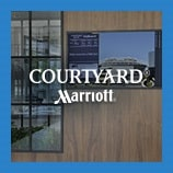Wall-mounted electronic Go-Board, opens the Courtyard Hotels brand page