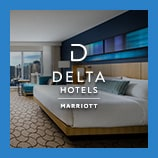 Large contemporary king room with city view, opens the Delta Hotels brand page