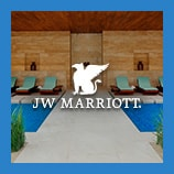 Covered outdoor lounge area and pool, opens the JW Marriott brand page