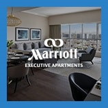 Living room with large windows, opens Marriott Executive Apartments brand page
