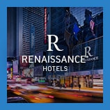 Hotel exterior and busy city street, opens the Renaissance Hotels brand page
