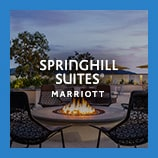 Scenic patio with fire pit, opens the Springhill Suites brand page