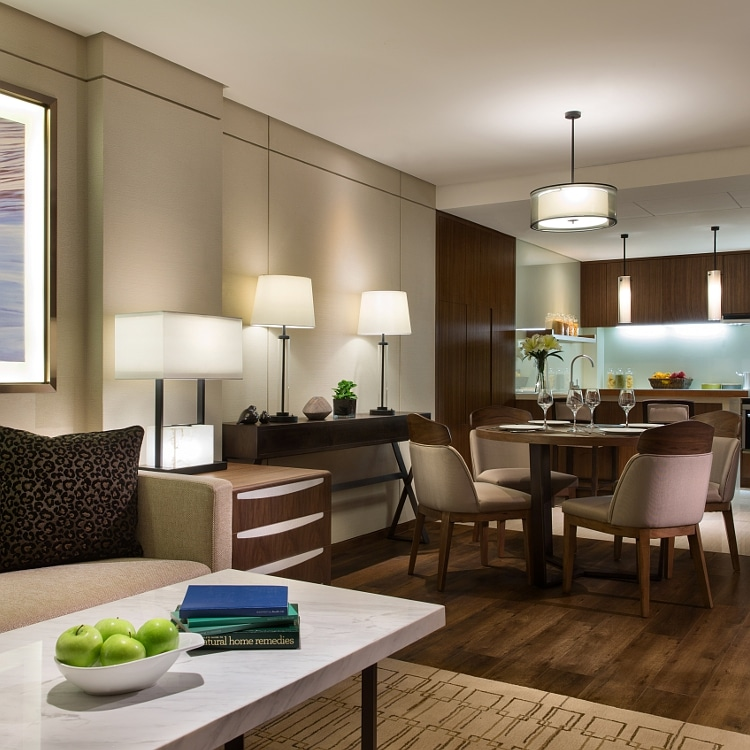 Hotel suite with dining table, chairs and sofa
