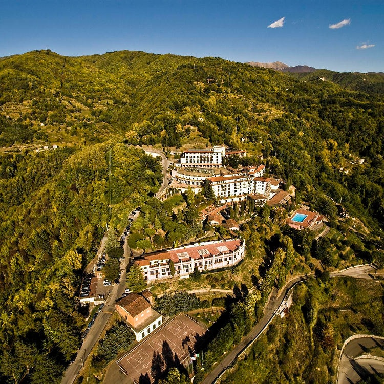 Aerial view of hillside hotel resort