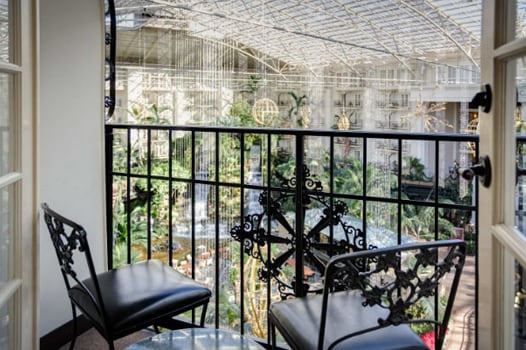 Table and chairs on balcony of atrium view room at Gaylord Opryland