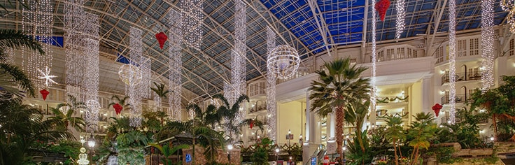 Dazzling holiday decorations in the vast Gaylord Opryland atrium.