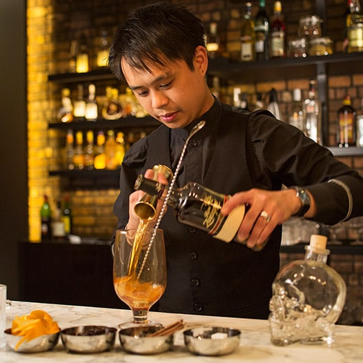 Bartender preparing drinks at JW Marriott Hotel Hong Kong/Link to JW Marriott Hong Kong dining page