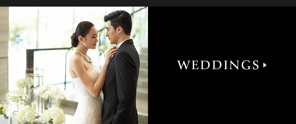 Image of bride & groom that links to the Weddings page