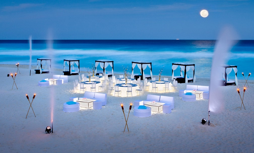 image of evening wedding on beach linked to JW Marriott Cancun Resort & Spa