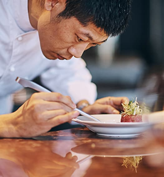 image of Sushi Chef platting linked to JW Marriott Hotel Zhengzhou