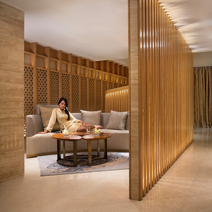 image of woman in spa link JW Marriott Hotel Chandigarh spa page