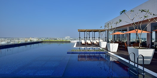 Outdoor pool with cabanas overlooking the city