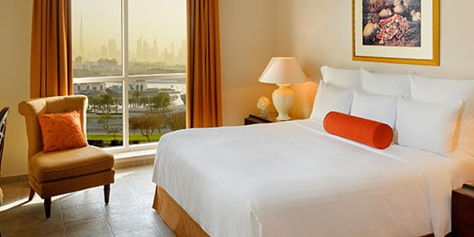 Bedroom with city skyline view