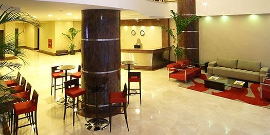Lobby with chairs, sofa and front desk