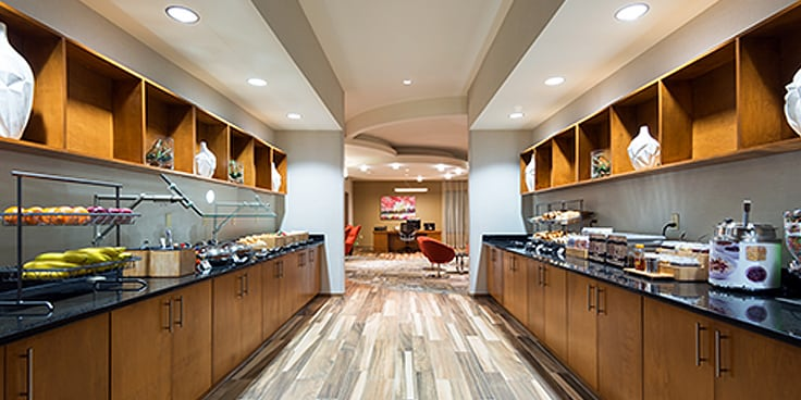 The hotel's free hot breakfast buffet, with fruit displays and food service