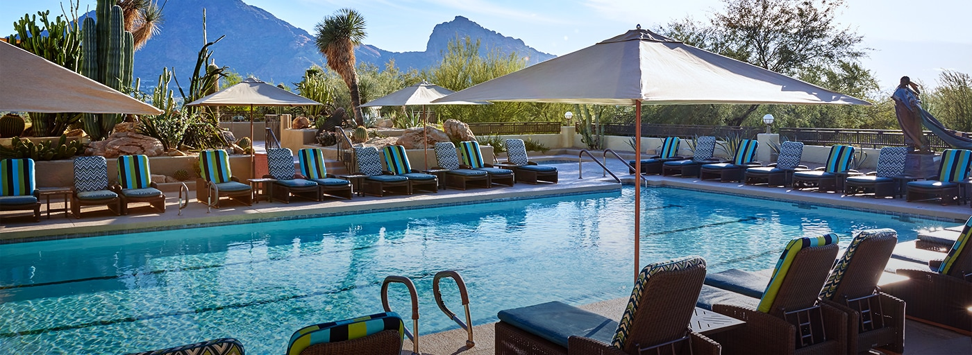 Pool And Plush Lounge Chairs With Mountains In The Background