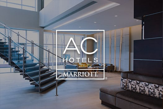 modern lobby seating and staircase, AC Hotels logo