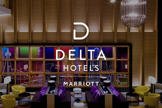 lobby seating with high ceiling, Delta Hotels logo