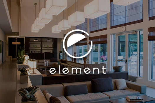 lobby seating by large windows, element logo