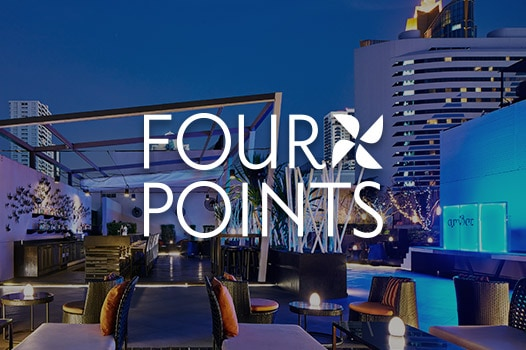 Rooftop Lounge bei Nacht, Four Points Logo