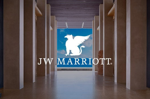 a hallway with ocean view and JW Marriott logo