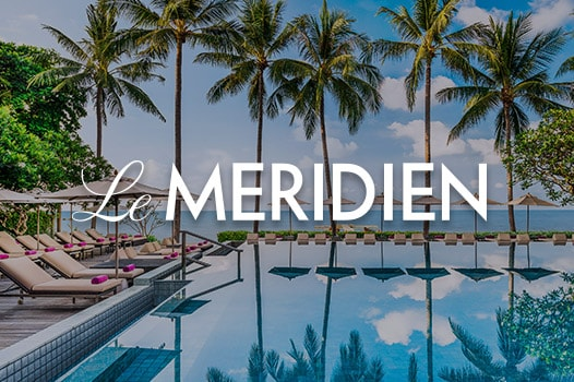 Oceanside pool, lounge chairs, umbrellas and palms, Le Meridien logo
