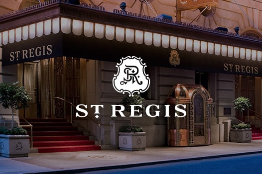 exterior entrance of St. Regis NYC  and St. Regis logo