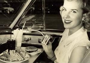 Enjoying in-car dining, 1952.