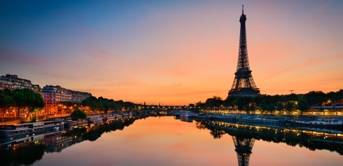 The Eiffel Tower overlooking the Seine in Paris