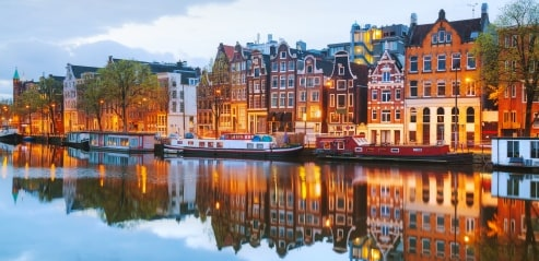 Row houses facing a canal in Amsterdam