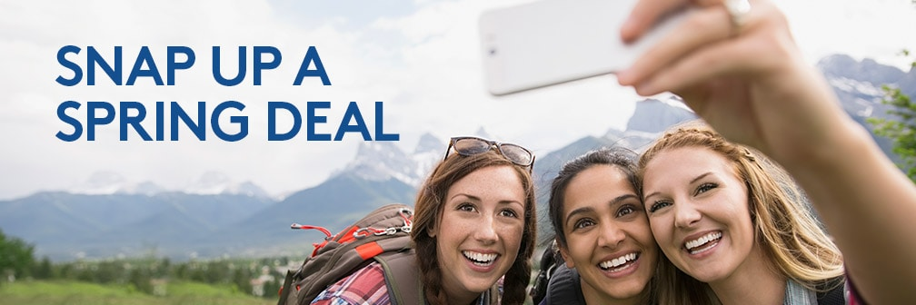 Snap up a spring deal. Image shows three young women taking a selfie during a mountain hike.