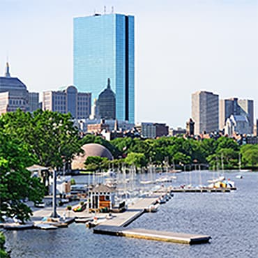 Water view in foreground and Boston skyline in background