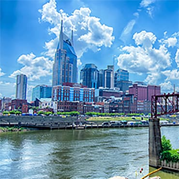 Nashville skyline in background with river in foreground.