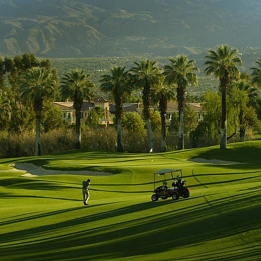 Golfer and golf cart on fairway    Link to Arizona golf package offer