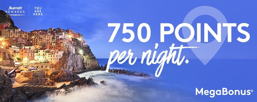 Coastal view of Manarola, Cinque Terre village at dusk. 750 points per night. MegaBonus logo.