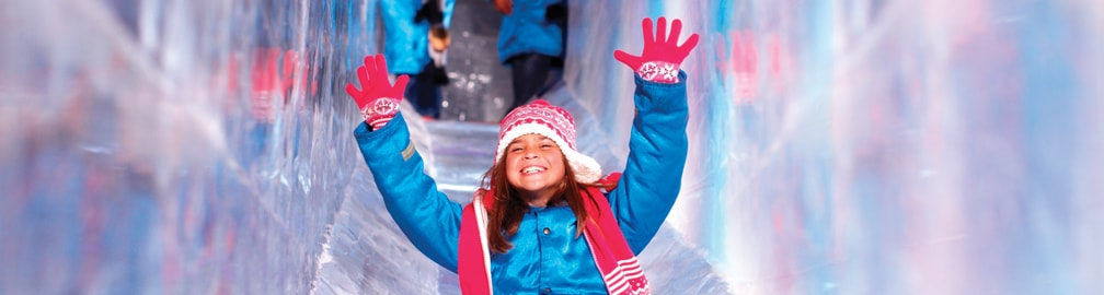 girl going down ice slide
