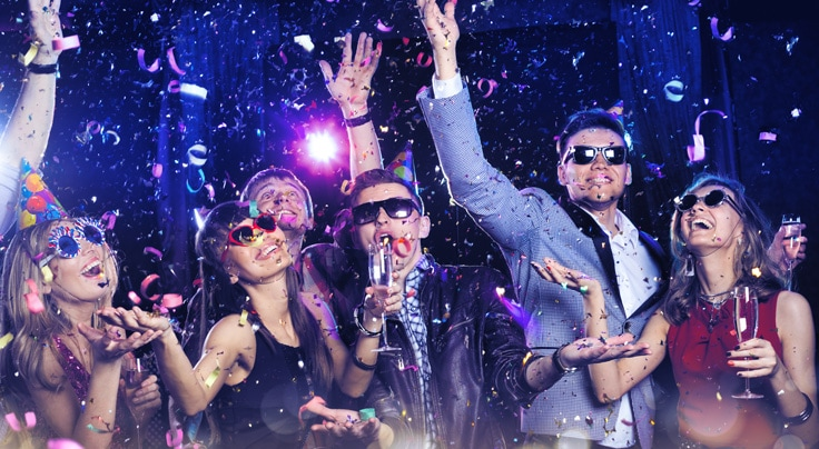 Group celebrating NYE with sunglass, streamers and chanpagne - link to offer details