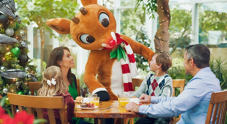 Family dining with Rudolph character during Lone Star Christmas at Gaylord Texan