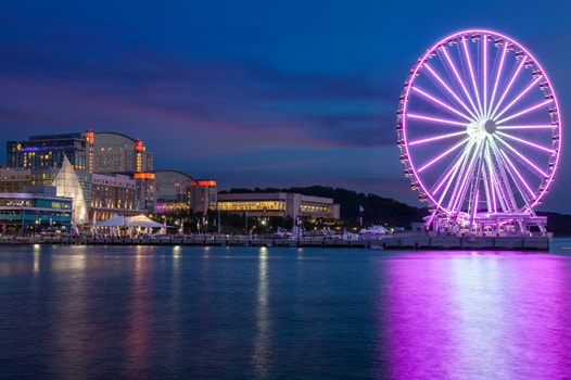 Night view Capital Wheel and Gaylord National on Potomac River