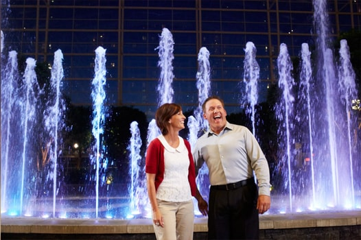 Couple in front of atrium fountain at Gaylord National