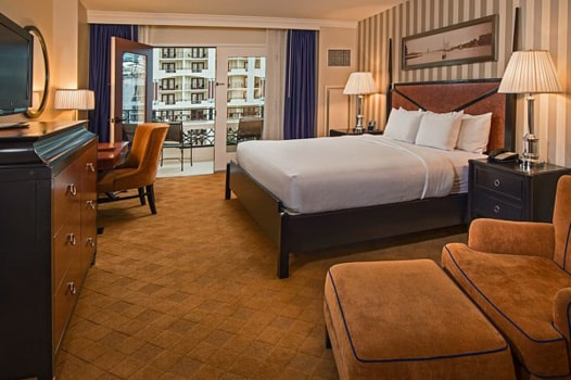 Bed in room looking out atrium view room at Gaylord National
