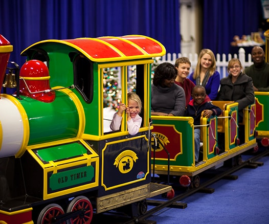 Families seated inside Kid's Train during Gaylord Opryland's A Country Christmas