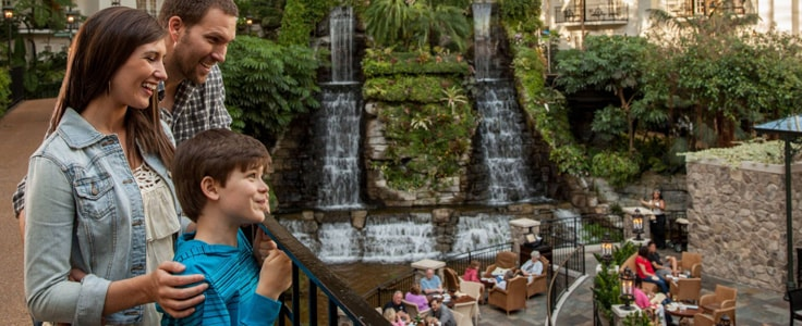 Family by waterfall at atrium at Gaylord Opryland