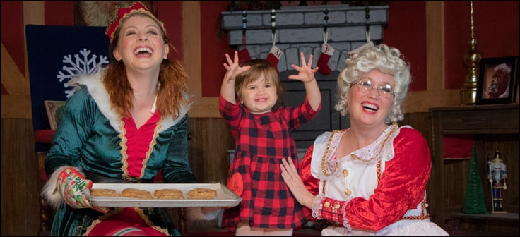 Toddler with Elf and Mrs. Claus - link to event details