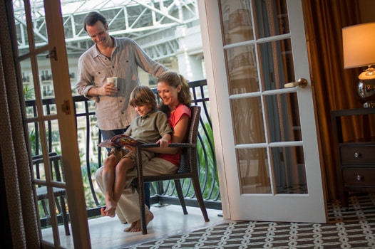 Family on balcony of atrium view room at Gaylord Palms