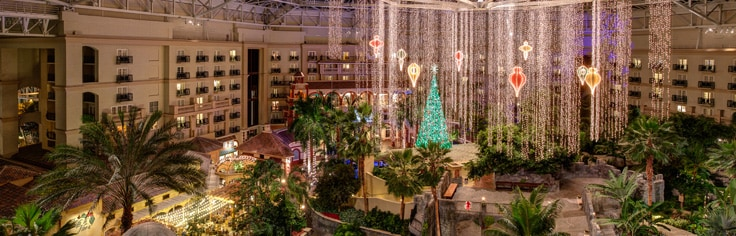 Dazzling holiday decorations and Christmas tree in the vast Gaylord Palms atrium.