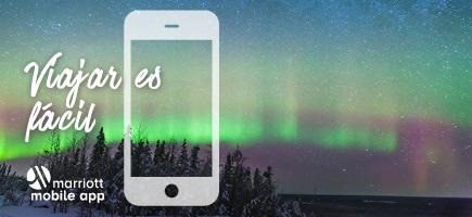 Cielo nocturno, auroras boreales.  Viajar es fácil. Marriott Mobile App logos.